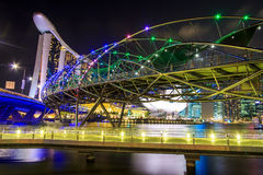 The Marina Bay Sands Resort Hotel link with Helix Bridge Stock Images