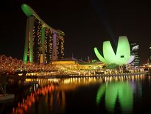 Marina Bay Sands Resorts by night. Brightly lit Marina Bay Sands Resort & Art Science Museum in Singapore Royalty Free Stock Images