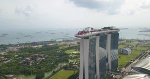Aerial footage of Marina Bay Sands, drone`s flying around the hotel, Singapore