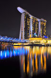 Marina Bay Sands Singapore. Night View of The Marina Bay Sands Hotel and the Double Helix Bridge with the water reflection Stock Images