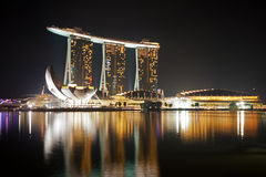 Marina Bay Sands in Singapore at dusk. ArtScience Museum and Marina Bay Sands in Singapore at dusk Royalty Free Stock Image