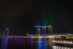 Marina bay sands in Singapore. Night laser show at Marina bay sands in Singapore stock images