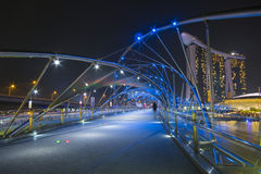 MARINA BAY SANDS, SINGAPORE OCTOBER 12, 2015: The Helix Bridge i. S a pedestrian bridge linking with Marina bay sands resort hotel at Singapore on October 12 Royalty Free Stock Photos