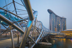 MARINA BAY SANDS, SINGAPORE OCTOBER 12, 2015: The Helix Bridge i. S a pedestrian bridge linking with Marina bay sands resort hotel at Singapore on October 12 Royalty Free Stock Photo