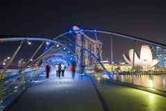 MARINA BAY SANDS, SINGAPORE OCTOBER 12, 2015: The Helix Bridge i. S a pedestrian bridge linking with Marina bay sands resort hotel at Singapore on October 12 Stock Photos