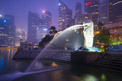 Marina bay sands, SINGAPORE OCTOBER 12, 2015: Merlion and skyscr Stock Images