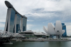 Marina Bay Sands and Waterfront, Singapore. Marina Bay Waterfront in Singapore, featuring Marina Bay Sands, lotus-shaped ArtScience Museum and Helix Bridge royalty free stock image