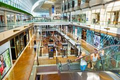 Marina Bay shopping mall, Singapore. SINGAPORE - FEB 17, 2017: Shopping mall at Marina Bay Sands Resort in Singapore. It is billed as the world`s most expensive Royalty Free Stock Photos