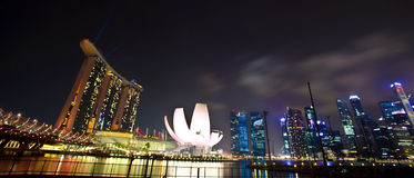 Marina Bay in Singapore as night landscape. As panorama view Royalty Free Stock Images