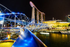 MARINA BAY, SINGAPORE , 2016: Helix bridge and Marina Bay Sand hotel at night, a popular destination for cityscape, SINGAPORE, 201 Stock Image