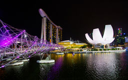 MARINA BAY, SINGAPORE , 2016: Helix bridge and Marina Bay Sand hotel at night, a popular destination for cityscape, SINGAPORE, 201 Royalty Free Stock Image