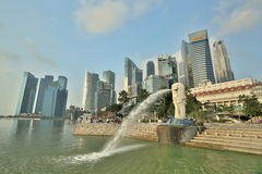 MARINA BAY ,SINGAPORE - March,14 2015: Early morning of Merlion. Statue Landmark Singapore country with sun rise front of Marina Bay Sands Resort Hotel Stock Photos