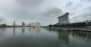 Marina bay, Singapore. A panoramic shot of Singapore's skylines including the famous Marina Bay Sands hotel with their reflection on the lake Stock Photos