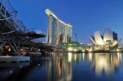 Marina Bay : Urban Landscape. A blue hour photo of the Marina Bay Sands Hotel and Integrated Resort with the Singapore Arts and Science Museum and the Double Stock Photos