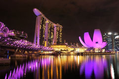 Marina Bays in purple.. SINGAPORE - DEC 29: Night view of Marina Bay Sands Resort Hotel on Dec 29, 2012 in Singapore. It is billed as the world's most expensive Royalty Free Stock Photography