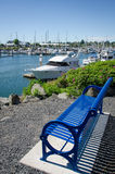 Marina at Bellingham, Washington. A beautifully crafted blue bench donated by the Rotary Club provides an excellent view of boats moored at Bellingham marina in Royalty Free Stock Photo
