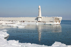 Marina into Black Sea, covered winter blanket of ice. Royalty Free Stock Photo