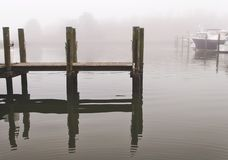 Marina Boat Pier in Maryland Fog. Pier Marina with boats in Havre de Grace, Maryland. It was a foggy morning royalty free stock photography