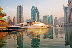 Marina Boats 6. Several boats and yachts berthed in the Dubai Marina with luxury apartments in the background Stock Photos