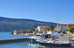 Marina with boats in the Djenovici town. Djenovici, Montenegro – February 6, 2016: Small marina with boats in the Djenovici town. This town has a population Stock Image