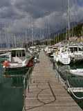 Marina with boats in Makarska. The entrance to the marina with boats in Makarska (Croatia, Dalmatia royalty free stock images