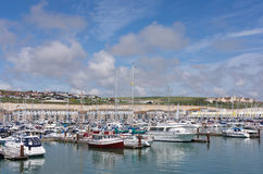 Boats moored in a busy marina Stock Images