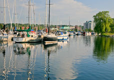 Marina with Boats Reflecting in the Water Royalty Free Stock Photography