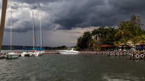Marina in Brasilia. A marina with sailing boats in Brasilia, Brazil and the storm weather clouds in the horizon Stock Images
