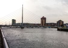 Marina with bridge. A view of Swansea marina sail bridge and appartment buildings in the background Royalty Free Stock Photo