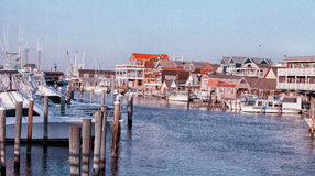 Marina in Cape May NJ US. Marinas and houses with red roofs reflected in the water. spring time in Cape May NJ Royalty Free Stock Photos