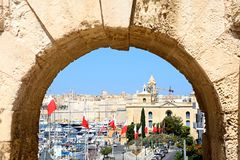 Marina and city seen through arch, Vittoriosa. View through an arch leading towards the war museum and marina waterfront, Vittoriosa Birgu, Malta, Europe Stock Photography