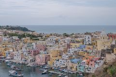 Marina Corricella, Italy, fishing village on the island of Procida with pastel coloured houses tumbling down the cliff to the se royalty free stock photo