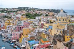 Marina Corricella, Italy, fishing village on the island of Procida with pastel coloured houses tumbling down the cliff to the se stock photography
