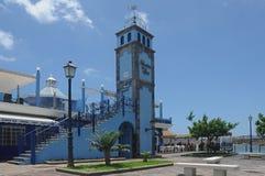 Marina del Sur, Las Galletas, Tenerife, Spain - June 10, 2012. The landmark blue building at the entrance of the small curving harbor of Las Galletas Stock Photos