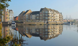 Marina development at Eynesbury. St Neots, Cambridgeshire, England - November 01, 2015: Marina development at Eynesbury buildings and reflection stock photography