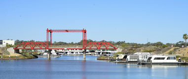 Marina Development, Mildura, Australia. A red metal bridge links two areas of this new marina development in Mildura. Houseboats line the waters edge royalty free stock photos