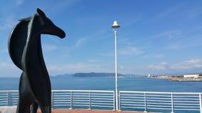 Marina di Massa bronze horse on the pontoon Royalty Free Stock Images