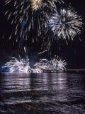 Firework by the sea in Marina di Massa. MARINA DI MASSA, ITALY - AUGUST 22 2015: Firework by the sea in Marina di Massa, Italy, from its famous pier Royalty Free Stock Photos