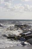 Waves crashing into rocks in Marina di Massa. MARINA DI MASSA, ITALY - AUGUST 17 2015: Waves crashing into rocks in Marina di Massa, Italy Stock Photography