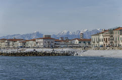 Marina di Pisa and Apuan Alps. Beach of Marina di Pisa and Apuan Alps Royalty Free Stock Photos