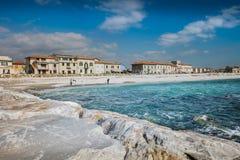 MARINA DI PISA, ITALY - Avril 24, 2017: View of the sea and the. Beach of white pebbles in Marina di Pisa Tuscany stock image