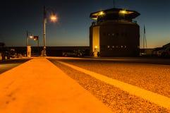 Marina di Scarlino Harbour après le coucher du soleil Image libre de droits