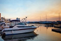 Marina with docked yachts at the end of the day. Concept of summer holidays stock images