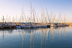 Marina with docked yachts at sunset stock photo