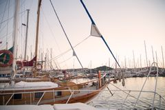 Marina with docked yachts at sunset Royalty Free Stock Image