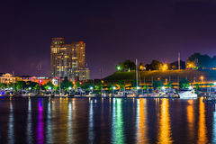 A marina and Federal Hill at night at the Inner Harbor in Baltim Royalty Free Stock Photography