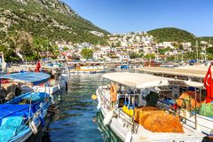 Marina with fishing boats and yachts in a sunny resort town. Horizontal stock image