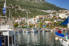 Marina with fishing boats and yachts in a sunny resort town. Horizontal royalty free stock image