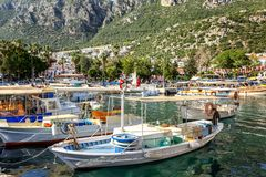 Marina with fishing boats and yachts in a sunny resort town. Horizontal stock photos