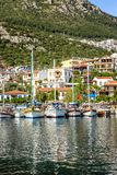 Marina with fishing boats and yachts in a sunny resort town. Vertical royalty free stock photos